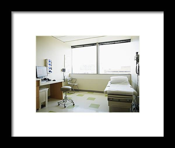 Empty Framed Print featuring the photograph Empty medical exam room by Thomas Barwick