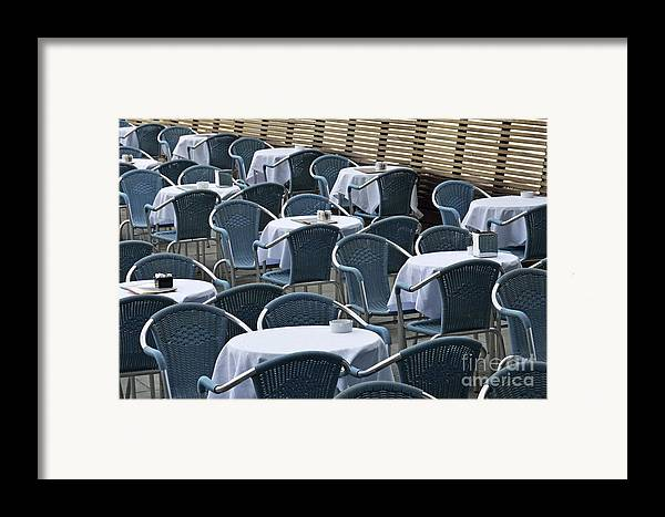 Blue Framed Print featuring the photograph Empty Restaurant Seats And Tables by Sami Sarkis