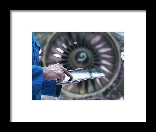 Focus Framed Print featuring the photograph Engineer Using Digital Tablet In Front by Monty Rakusen