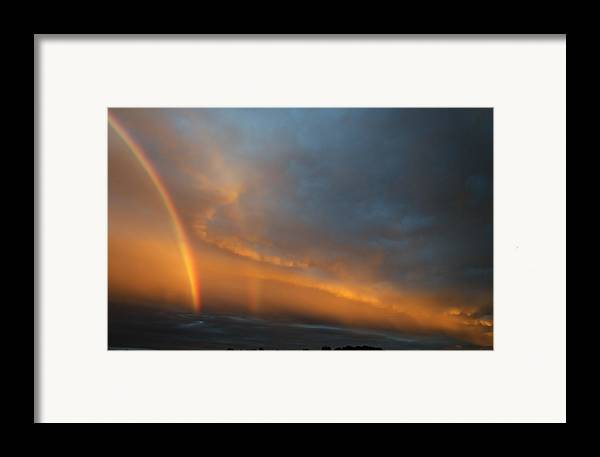 Rainbow Framed Print featuring the photograph Ethereal Clouds And Rainbow by Greg Reed