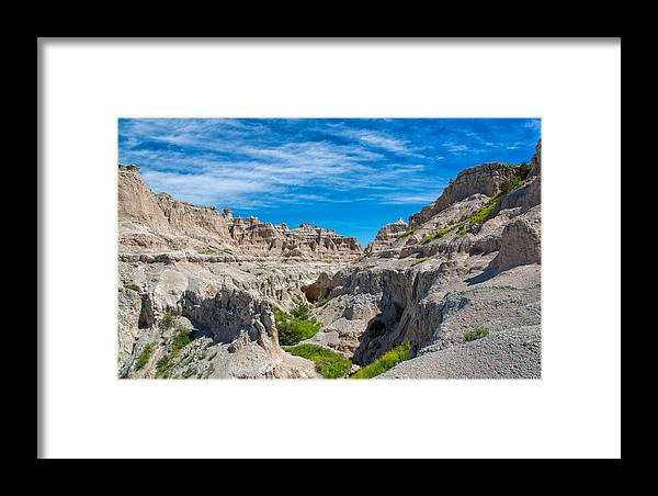 Landscape Framed Print featuring the photograph Exploring The Badlands by John M Bailey