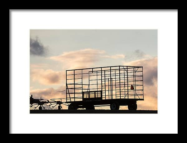 Sunset Framed Print featuring the photograph Farm Equipment At Sunset by Tom Bushey