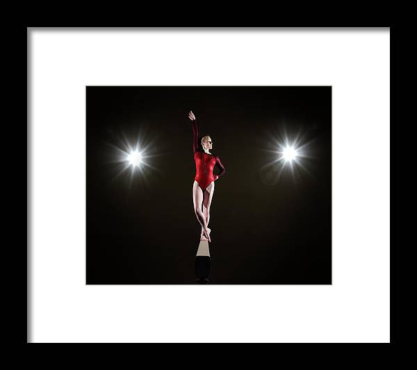 Human Arm Framed Print featuring the photograph Female Gymnast On Balancing Beam by Mike Harrington