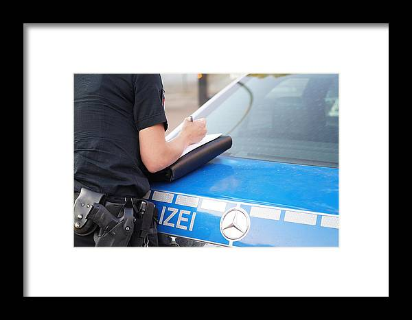 Female Police Officer Writes A Report On The Crime Framed Print