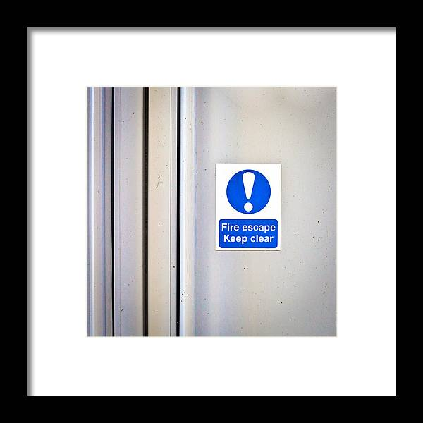 Blue Framed Print featuring the photograph Fire Exit by Tom Gowanlock