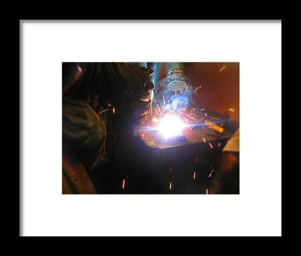 Welding Framed Print featuring the photograph Fire Finger by Sabasion Bentley-Dyess
