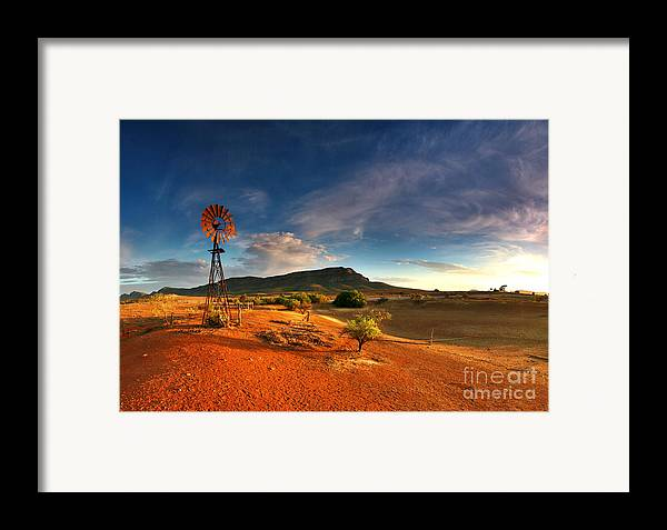 First Light Early Morning Windmill Dam Rawnsley Bluff Wilpena Pound Flinders Ranges South Australia Australian Landscape Landscapes Outback Red Earth Blue Sky Dry Arid Harsh Framed Print featuring the photograph First Light On Wilpena Pound by Bill Robinson