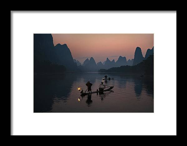 Fisherman Framed Print featuring the photograph Fisherman Of The Li River by Mieke Suharini