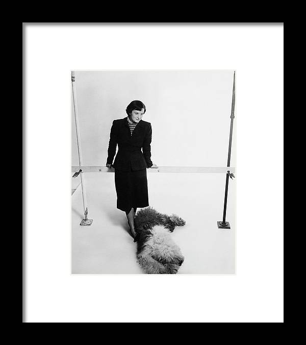 Designer Framed Print featuring the photograph Florence Knoll And Her Dog by Herbert Matter