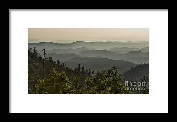 Southwest Framed Print featuring the photograph Foggy Morning Over Waterpocket Fold by Sandra Bronstein