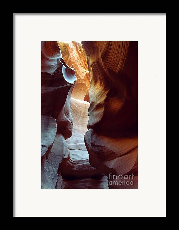 Slot Canyon Framed Print featuring the photograph Follow The Light II by Kathy McClure