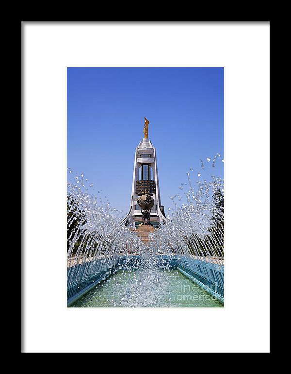 Turkmenistan Framed Print featuring the photograph Fountains And The Arch Of Neutrality At Ashgabat In Turkmenistan by Robert Preston