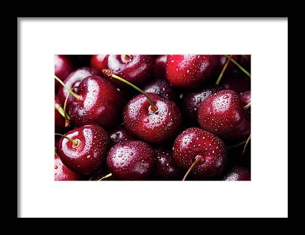 Cherry Framed Print featuring the photograph Fresh Ripe Black Cherries Background by Anna Pustynnikova