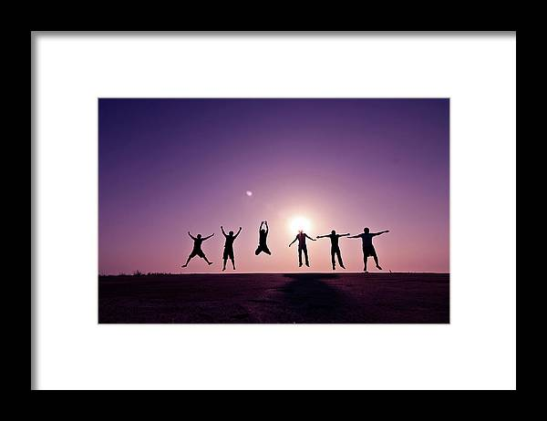 Human Arm Framed Print featuring the photograph Friends Jumping Against Sunset by Kazi Sudipto Photography