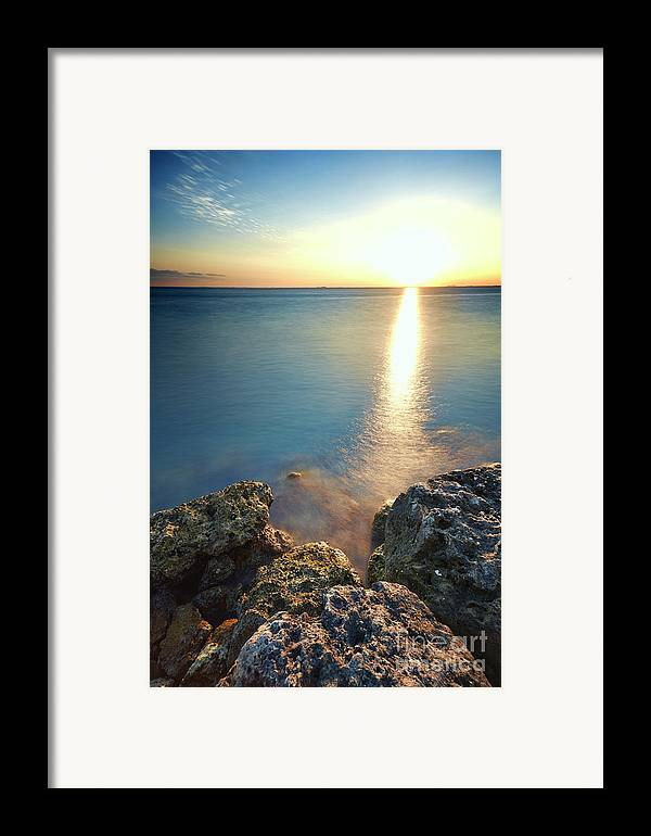 Rocks Framed Print featuring the photograph From The Sea Rocks by Eyzen M Kim