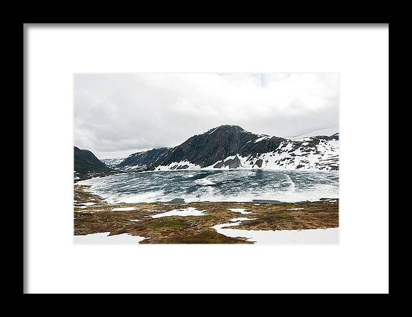 Tranquility Framed Print featuring the photograph Frozen Lake - Dalsnibba Mountains by Thierry Dosogne