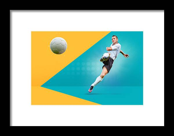 Soccer Uniform Framed Print featuring the photograph Full Length Of Man Playing Soccer Against Colored Background by Val Thoermer / EyeEm