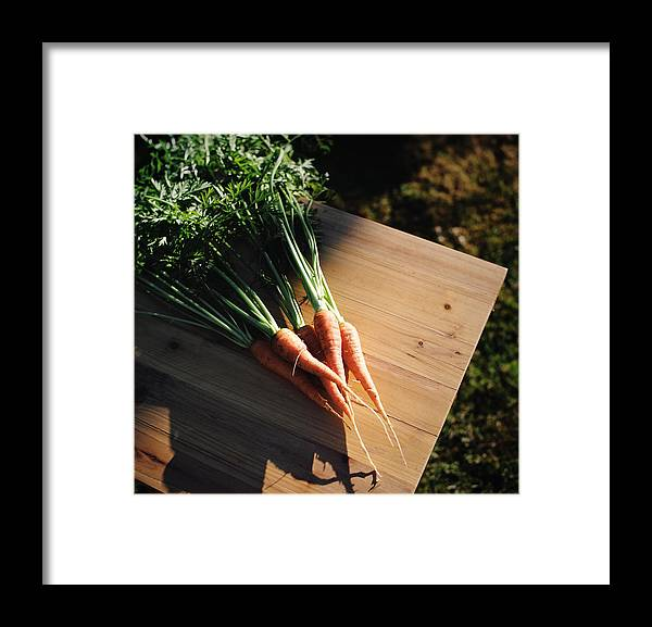 Five Objects Framed Print featuring the photograph Garden Carrots On Sunny Stool by Danielle D. Hughson