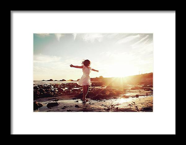 Human Arm Framed Print featuring the photograph Girl Dancing On Beach At Sunset Sun Rays by Dianne Avery Photography