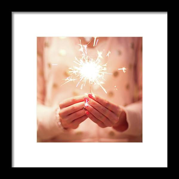 Firework Display Framed Print featuring the photograph Girl Holding Small Sparkler by Sasha Bell