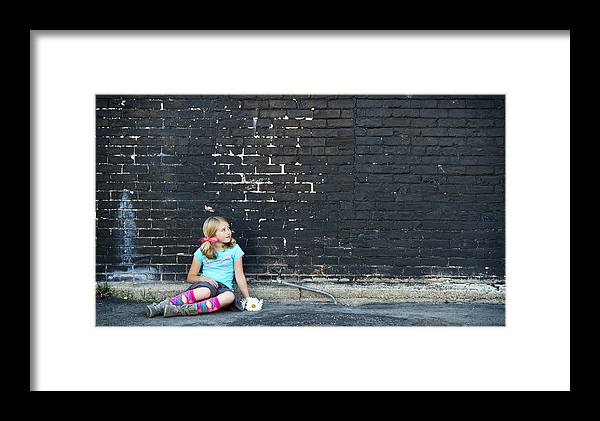 Adolescence Framed Print featuring the photograph Girl Sitting On Ground Next To Brick Wall by Jennifer Huls