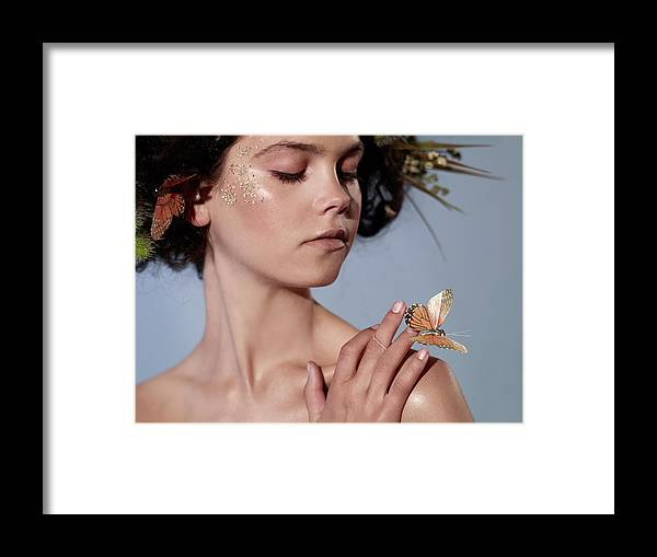 Tranquility Framed Print featuring the photograph Girl With Butterfly In Hand by Bill Diodato