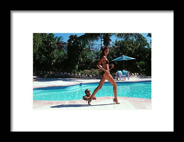 Fashion Framed Print featuring the photograph Gisele Bundchen Walking Poolside by Arthur Elgort
