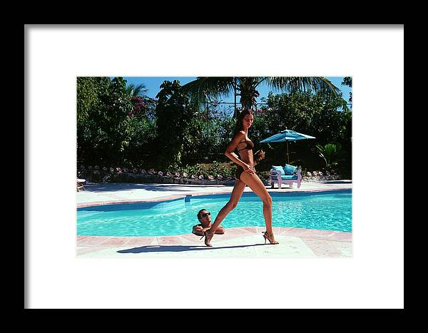Fashion Framed Print featuring the photograph Gisele Bundchen Walking Poolside by Arthur Elgort
