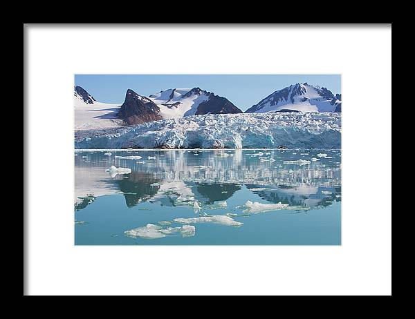 Scenics Framed Print featuring the photograph Glaciers Tumble Into The Sea In The by Anna Henly