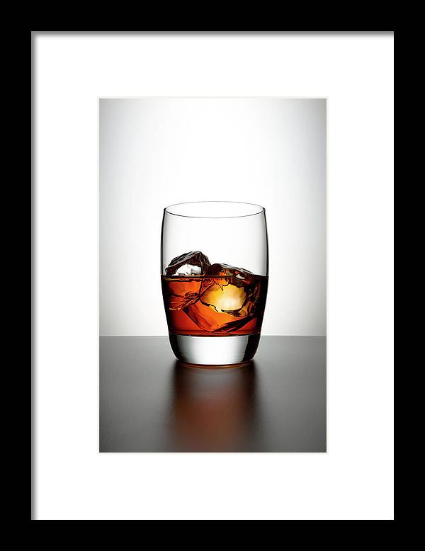 White Background Framed Print featuring the photograph Glass With Brown Liquor And Ice Cubes by Chris Stein