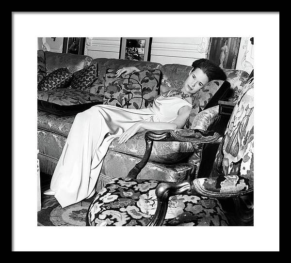 Gloria Vanderbilt Reclining On A Couch by Horst P. Horst