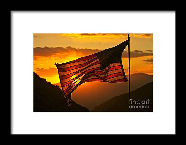 American Flag Framed Print featuring the photograph Glory At Sunset by Michael Cinnamond