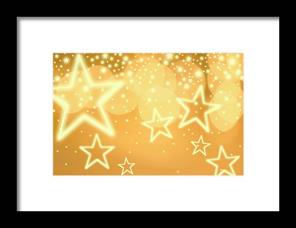 Christmas Lights Framed Print featuring the photograph Glowing Background With Stars, Studio by Tetra Images