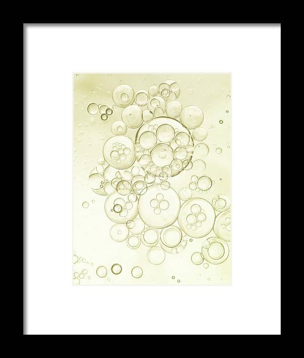 Purity Framed Print featuring the photograph Gold Bubbles Of Oil And Water by Level1studio