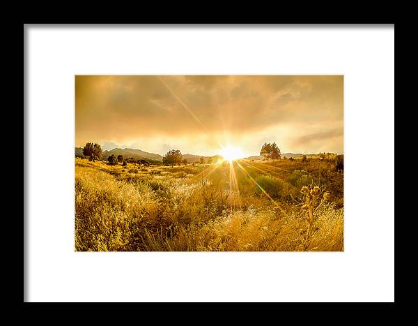 Golden Glow Framed Print featuring the photograph Golden Smoke by Emily Dickey
