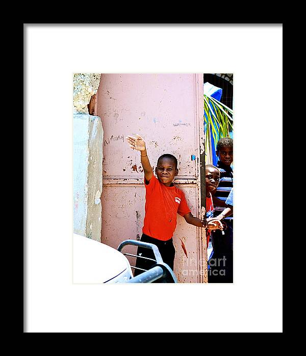 Haitian Boy - Good-bye Wave Framed Print featuring the photograph Good-bye by Steven Baier