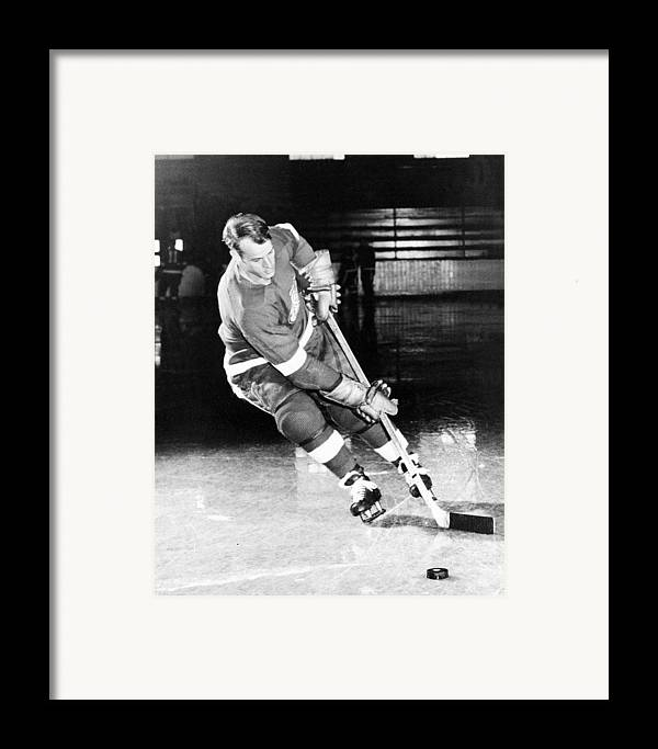 Gordie Framed Print featuring the photograph Gordie Howe Skating With The Puck by Gianfranco Weiss