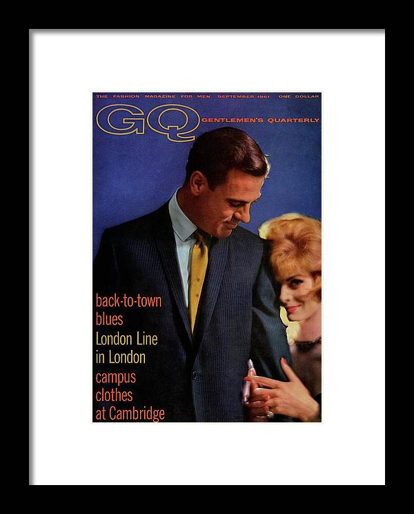 Fashion Framed Print featuring the photograph Gq Cover Featuring A Male And Female Model by Richard Waite