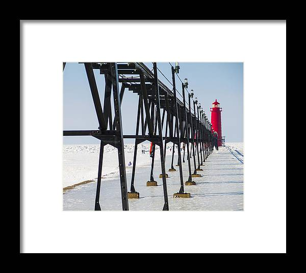 Grand Haven Framed Print featuring the photograph Grand Haven Lighthouse Pier In Winter by Kirsten Dykstra