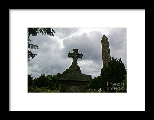 Glendalough Framed Print featuring the photograph Grave Cross And The Round Tower by Nancy L Marshall