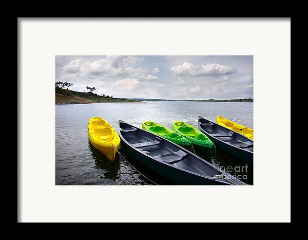 Activity Framed Print featuring the photograph Green And Yellow Kayaks by Carlos Caetano