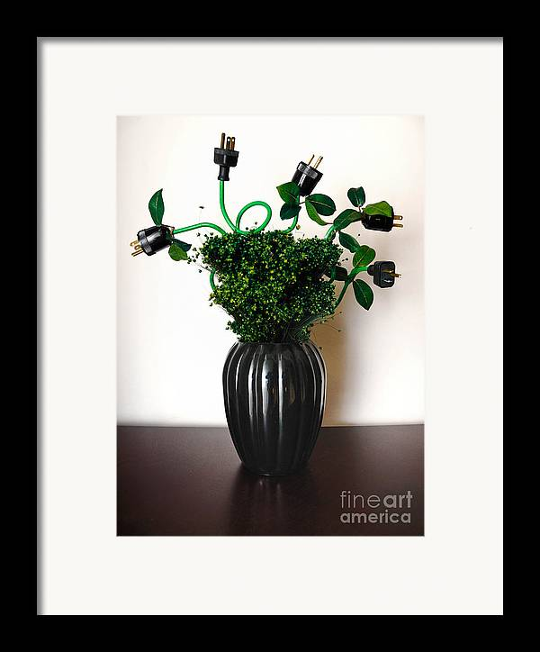 Alternative Energy Framed Print featuring the photograph Green Energy Floral Arrangement Of Electrical Plugs by Amy Cicconi