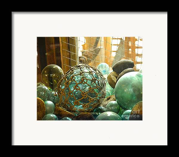Ocean Floats Framed Print featuring the photograph Green Glass Japanese Glass Floats by Artist and Photographer Laura Wrede