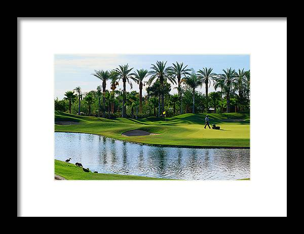 Working Framed Print featuring the photograph Greens-keeper Tending Golf Course by John Hay