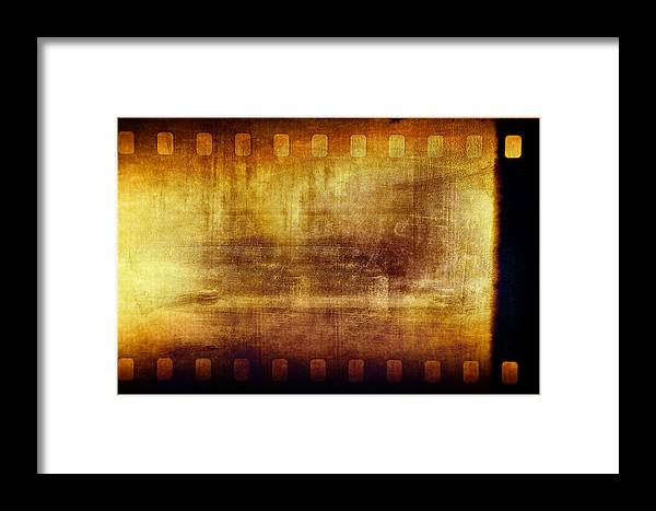 Film Framed Print featuring the photograph Grunge Filmstrip by Les Cunliffe
