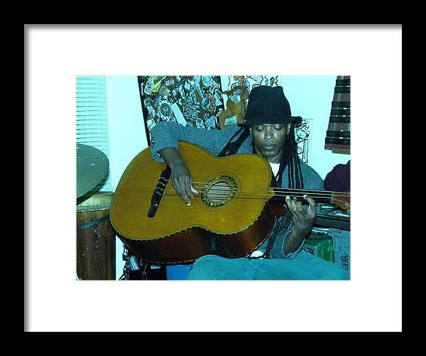 Guiltar Player Framed Print featuring the photograph Gully Guitar And Black Hat by Cleaster Cotton