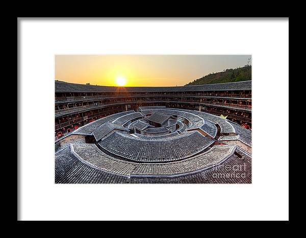 Ancient Framed Print featuring the photograph Hakka Tulou Traditional Chinese Housing At Sunset by Fototrav Print