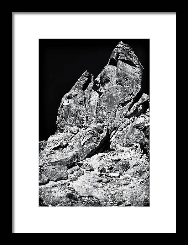 Hand In The Desert Framed Print featuring the photograph Hand in the Desert by John Rizzuto
