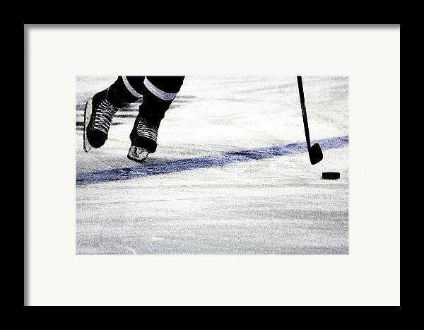 Hockey Framed Print featuring the photograph He Skates by Karol Livote