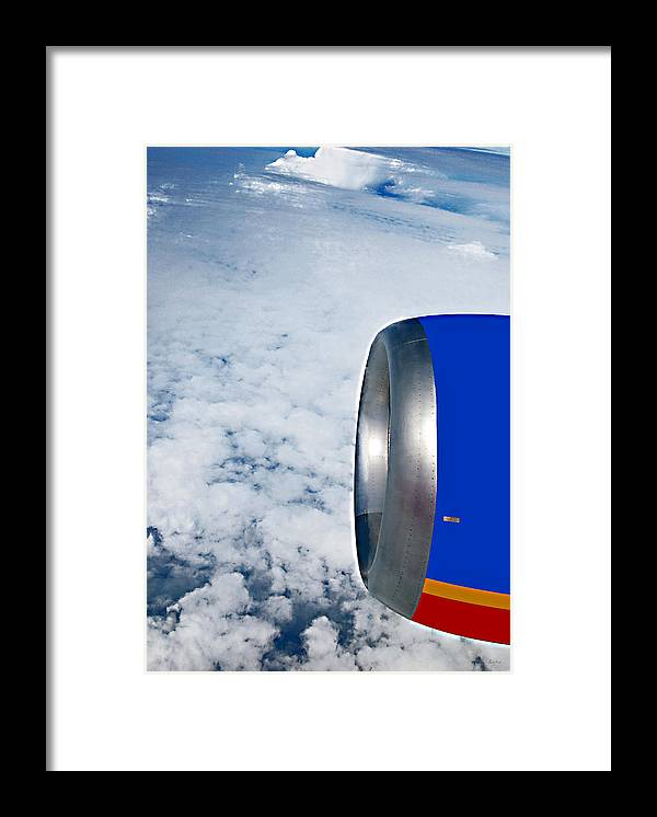 Jet Framed Print featuring the photograph Head Above The Clouds by Donna Proctor